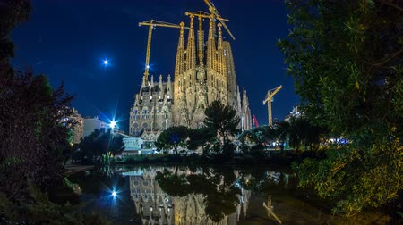 modernist : Sagrada Familia, a large church in Barcelona, Spain night timelapse.