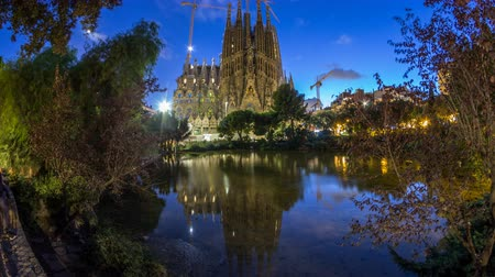 splendid : Sagrada Familia, a large church in Barcelona, Spain day to night timelapse. Stock Footage