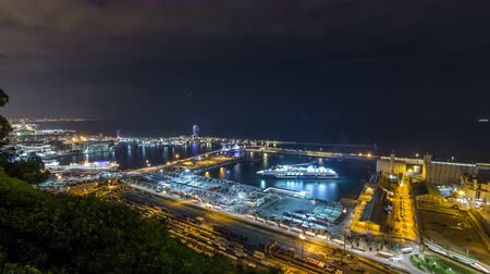 cityspace : Night skyline from Montjuic with Port Vell timelapse, Barcelona, Catalonia, Spain