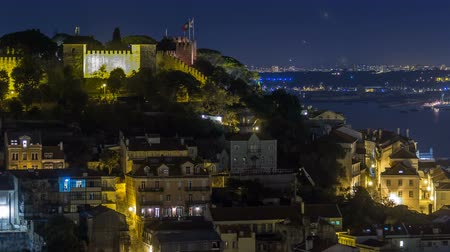miradouro : Lisbon aerial panorama view of city centre with illuminated building at Autumn night timelapse, Portugal