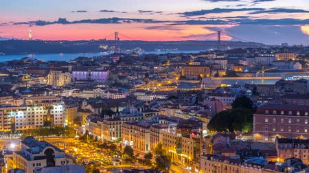 lizbona : Lisbon after sunset aerial panorama view of city centre with red roofs at Autumn day to night timelapse, Portugal