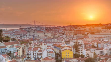 alfama : Lisbon at sunset aerial panorama view of city centre with red roofs at Autumn evening timelapse, Portugal Stock Footage