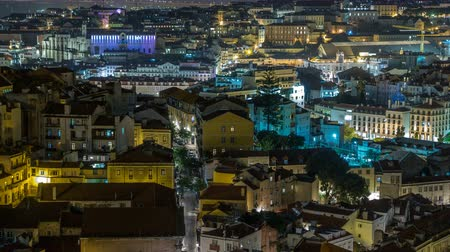 red square : Lisbon aerial panorama view of city centre with illuminated building at Autumn night timelapse, Portugal