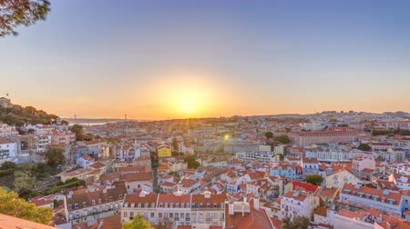 çatılar : Lisbon at sunset aerial panorama view of city centre with red roofs at Autumn evening timelapse, Portugal Stok Video