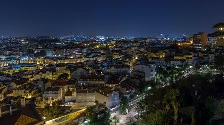 alfama : Lisbon aerial panorama view of city centre with illuminated building at Autumn night timelapse, Portugal