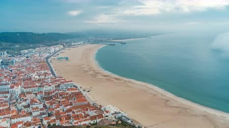 miradouro : View of Nazare panorama with cabins of Funicular timelapse. Fog coming from ocean at evening during sunset.