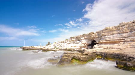 roaring : Seascape from the deserted shore to the caspian sea with blue sky and roaring waves timelapse