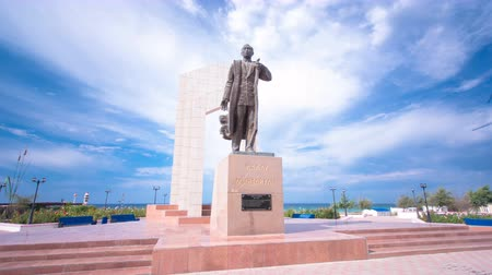 first officer : Monument to Zhalau Mynbayev in Aktau timelapse hyperlapse. Kazakhstan. Stock Footage