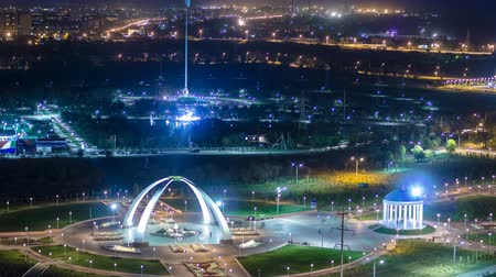 straight road : Park named after the First President of the Republic of Kazakhstan in the city of Aktobe night timelapse. Western Kazakhstan. Stock Footage