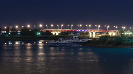 ural : Ship and illuminated bridge on the riverside Ural in city Atyrau timelapse hyperlapse