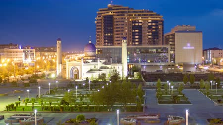 安定性 : Mosque in center and park in city Atyrau day to night timelapse hyperlapse. 動画素材