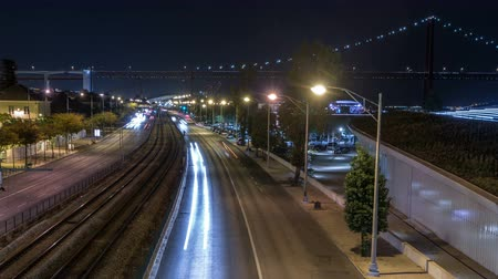 zumbido : Car light trails timelapse. Night view of India Avenue in Belem zone in Lisbon Portugal