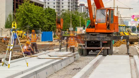 hawser : Installing concrete plates by crane at road construction site timelapse.