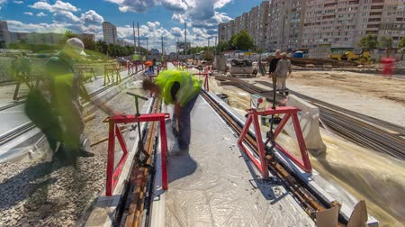 bütünleşme : Tram rails at the stage of their installation and integration into concrete plates on the road timelapse hyperlapse.