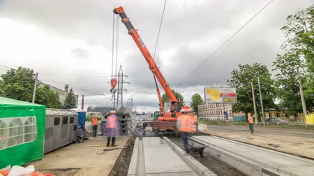 miktar : Unloading concrete plates at road construction site timelapse. Stok Video