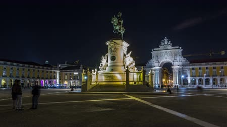 arco : Triumphal arch at Rua Augusta and bronze statue of King Jose I at Commerce square night timelapse hyperlapse in Lisbon, Portugal.
