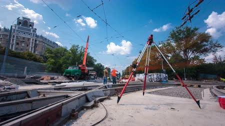 geodesy : Installing concrete plates by crane at road construction site timelapse hyperlapse.