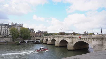 neuf : PARIS, FRANCE - OCTOBER 05: cruise ship floating in river Seine under Pont Neuf, Paris, France Stock Footage