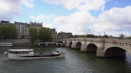 neuf : PARIS, FRANCE - OCTOBER 05: Pont Neuf and river Seine waters with cruise ship, blue sky with clouds, Paris, France Stock Footage