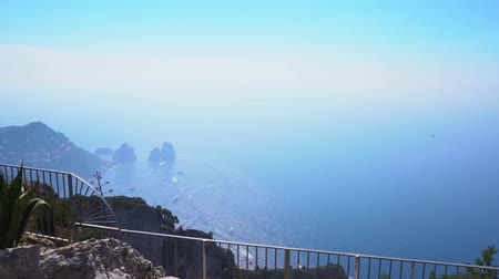 amalfi coast : Famous Faraglioni cliffs and Tyrrhenian Sea blue water, Capri island, Italy