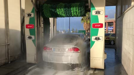 muck : PUERTO CRUZ, TENERIFE - FEBRUARY 15, 2018 gray car is being washed in automatic car wash