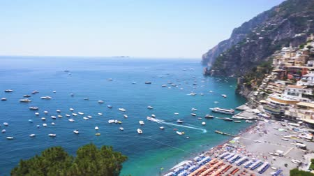 amalfitana : Tyrrhenian Sea coast with boats near Positano, Amalfi coast Italy Stock Footage