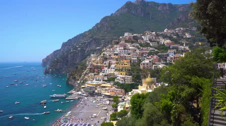 amalfi coast : POSITANO, ITALY - JULY 12, 2017: People relaxing at Positano houses on the rock - famous old italian resort, Italy Stock Footage