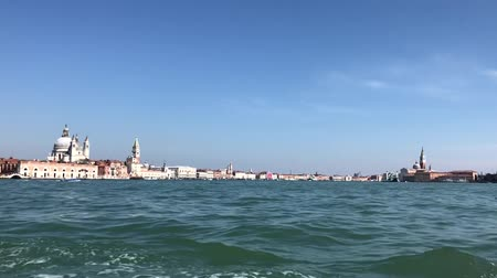 bell tower : VENICE, ITALY - MARCH 23, 2018: boats floating in front of Venice waterfront with Santa Maria della Salute and San Marco square, view from ship, Venice, Italy