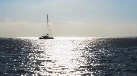 amalfitana : sea water, yacht boat and sunshine in back harsh light, Italy