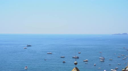 neapol : Tyrrhenian Sea waters with floating boats near Positano, Amalfi coast Italy