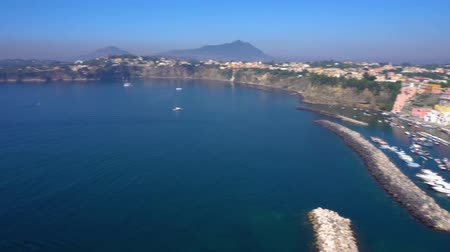 neapol : Procida island with colorful houses, harbour aerial view with Thyrenian sea, Italy