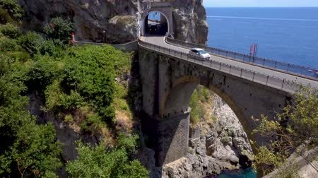 amalfitana : car driving on famous picturesque road viaduct over sea of Amalfi coast, Italy