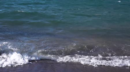 abstract splash : Clean sea water at amalfitana volcanic beach, Italy Stock Footage
