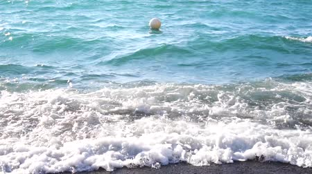 amalfitana : Clean sea water waves at amalfitana volcanic beach, Italy, slow motion