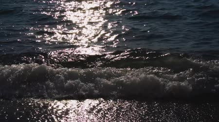 amalfitana : Sea water and yach with sun glares in back light, Meta di Sorrento at summer, Italy
