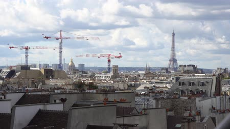 eifel : clouds floating over famous Eiffel Tower and Paris roofs, Paris France