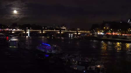 eifel : Ship and boats passing by Pont de la Concorde, night in Paris, France