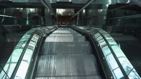 Moving iron empty escalator stairs, slow motion