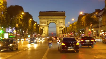triumphal arch : PARIS, FRANCE - OCTOBER 06, 2017: different car driving in front of Arc de Triomphe at night, Paris, France Stock Footage
