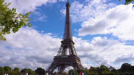 eifel : clouds flowing over Eiffel Tower with trees, Paris France