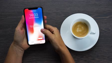 face id : WARSAW, POLAND - DECEMBER 02, 2017: Woman opening New Iphone X mobile phone changing setting and watching Pinterest at 2 december 2017 Stock Footage