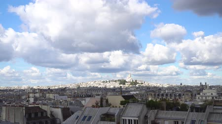 çatı : view of Paris Mont Matre hill and parisian roofs ubder blue sky with clouds getting darker and lighter, France Stok Video