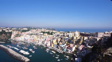 Procida island skyline with colorful houses, harbour aerial view, Italy Стоковые видеозаписи