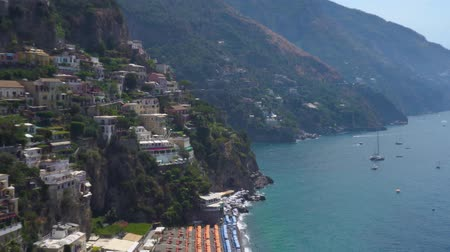 amalfi : Positano houses on the rock getting closer - famous old italian resort and Tyrrenian sea water, Italy