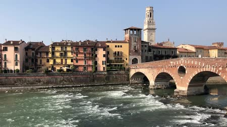 Riverbank with roman bridge in old town of Verona, Italy