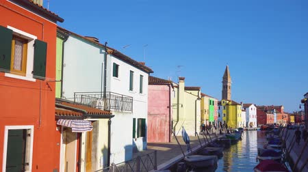 canal with multicolored houses of Burano island, Venice, Italy