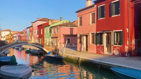view of canal with multicolored houses of Burano island, Venice, Italy Stok Video