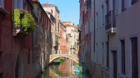 traitional Venice canal with reflection of houses, Italy