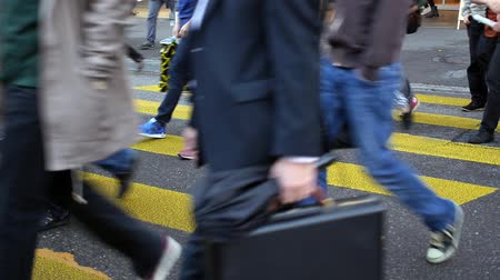 cruzamento : HD 1080p - Busy crowds walk over zebra crossing in Zurich. People walk around very hectic and try to catch their next Tram or bus.  Stock Footage