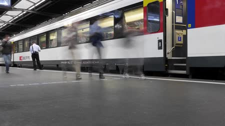 train station : HD 1080p - Busy crowds at Train station in Zurich. People walk around very hectic and try to catch their next Train.  Stock Footage